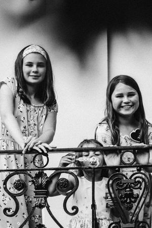 Young guests at a wedding 131 Cheltenham in black and white on banister