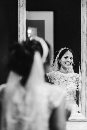 Wedding photograph of the bride looking super happy in the mirror at 131 Cheltenham