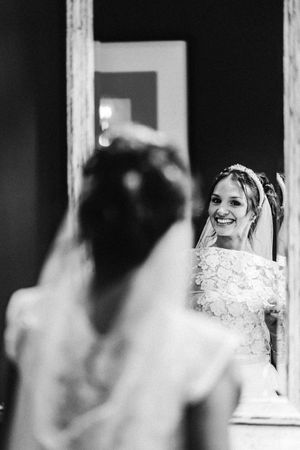 Bridal prep photograph bride looking in the mirror at 131 happy