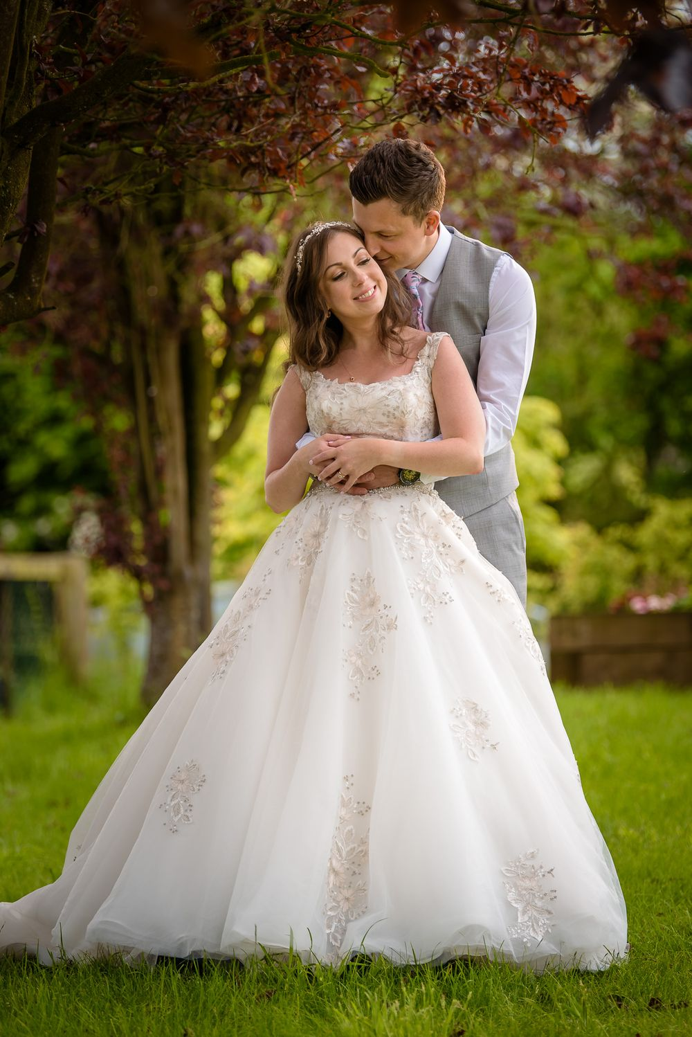 Bride and groom in garden after Lake District wedding