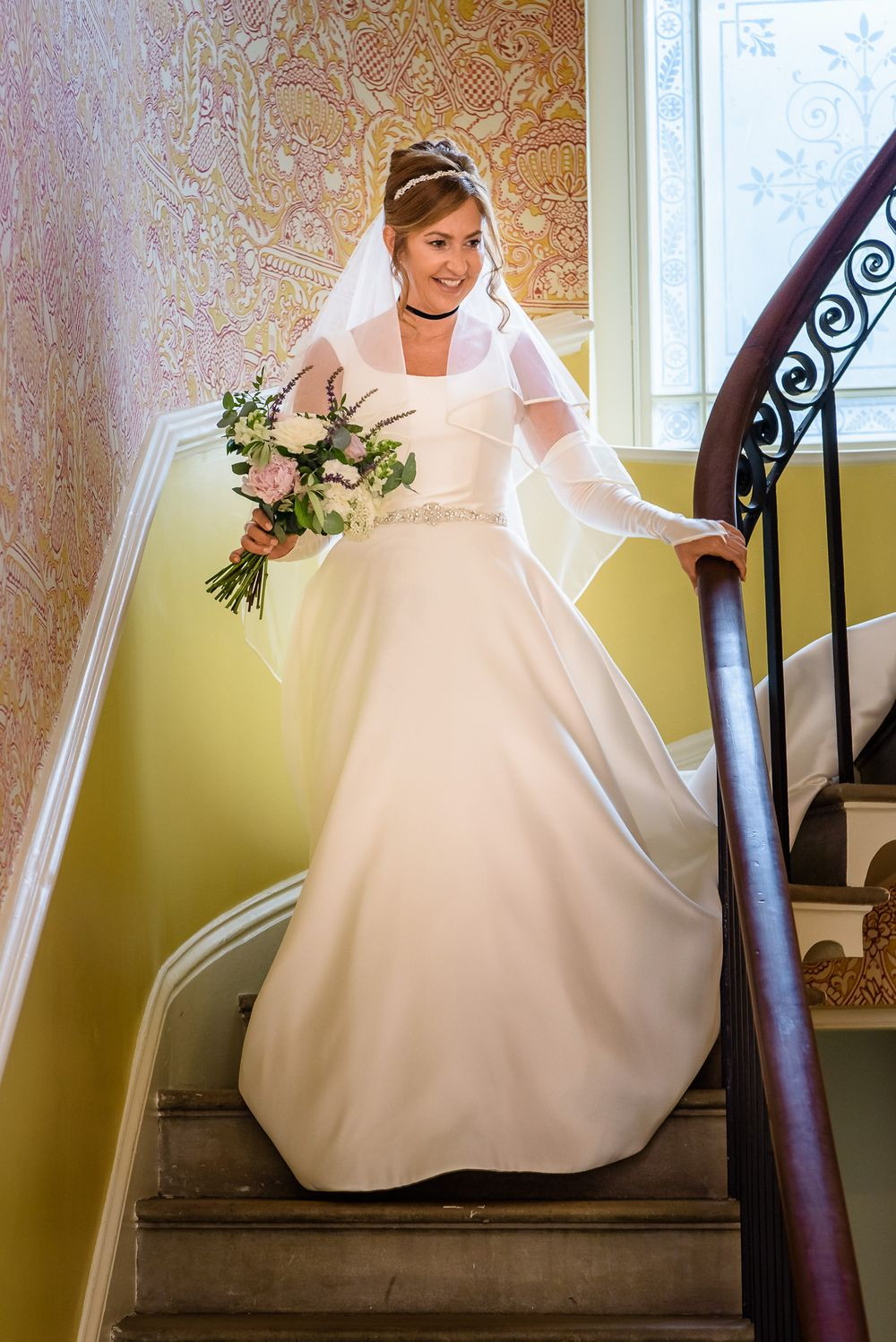 Bride coming down stairs at Silverholme Manor