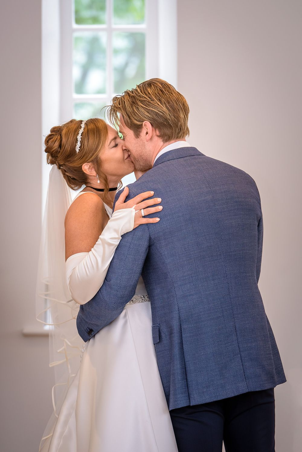 First kiss for bride and groom at Silverholme Manor wedding