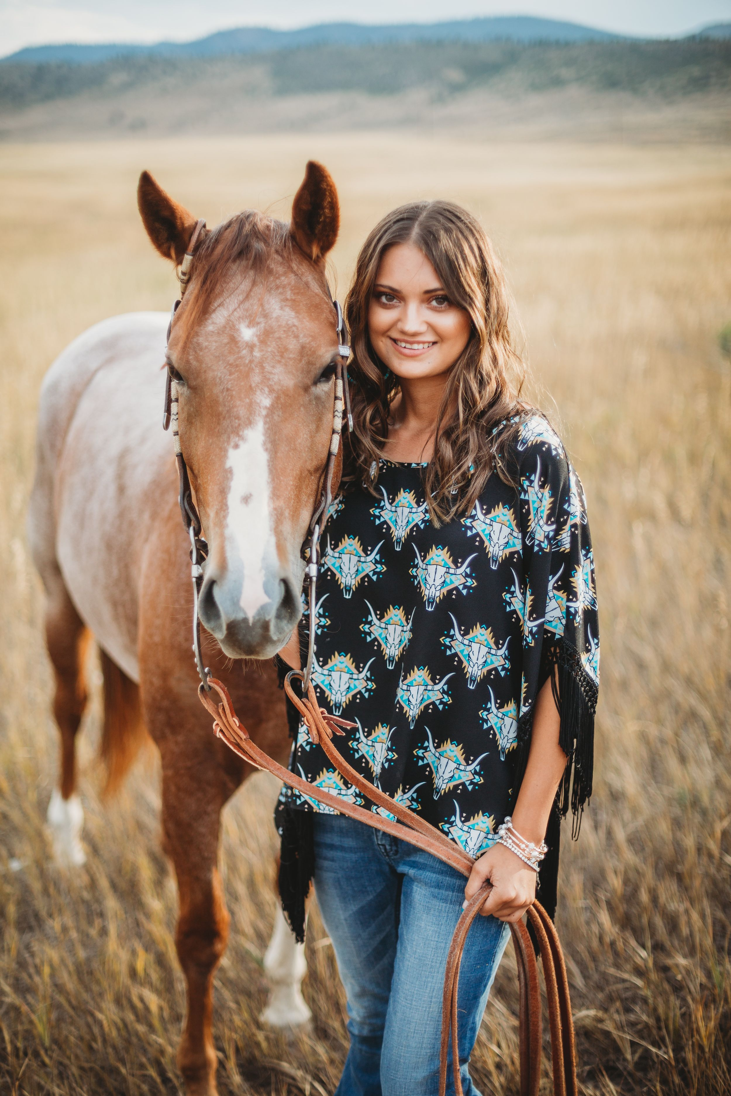 An Eaton High School senior poses for a photo with her horse during a Senior Photography Session at Reservoir Ridge.