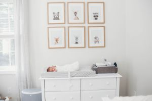 infant on her changing table by newborn photographer worcester ma