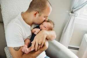 dad kissing his son by family photographer worcester ma