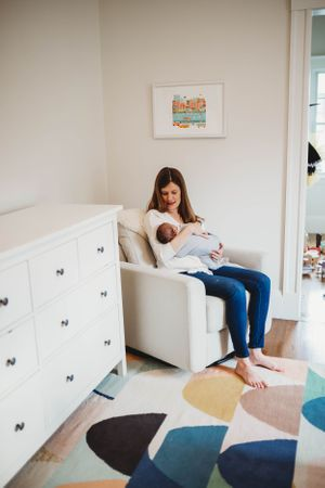 mom in nursery by sterling MA photographer