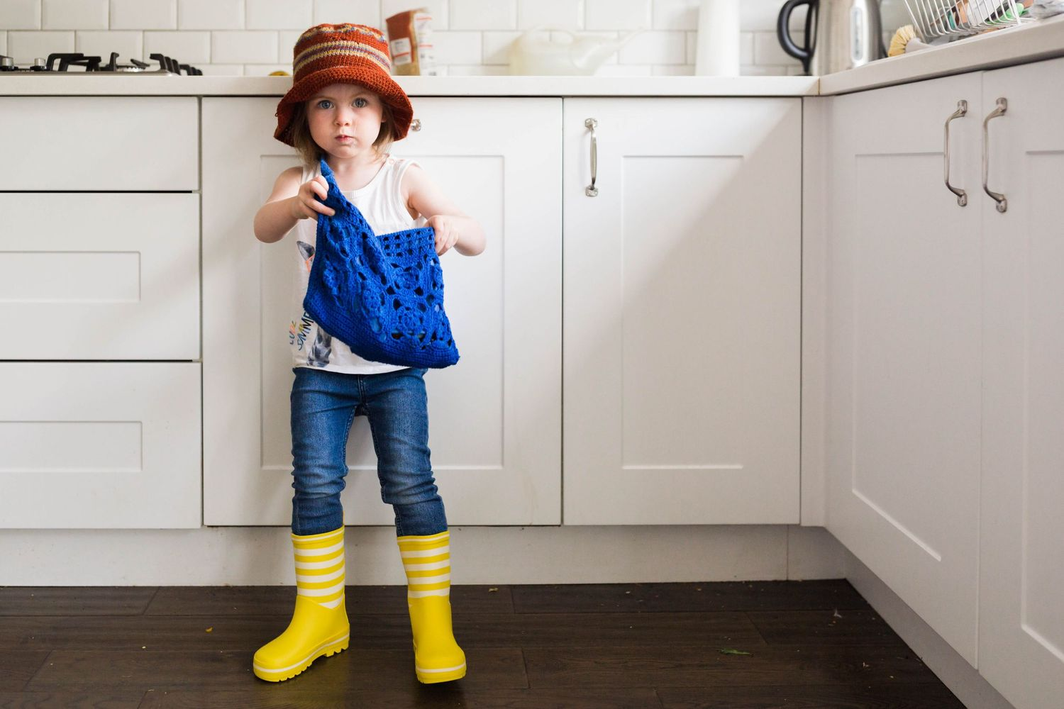 emilia at three years old dressed in funny clothes yellow wellies