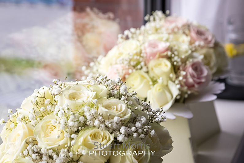 the bridesmaids bouquets lined up the window sill at the crowne plaza hotel
