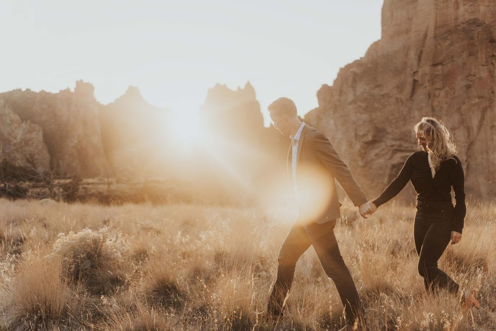 Photo by Kelsie Burke Photography of the couple walking hand in hand through Smith Rock State Park