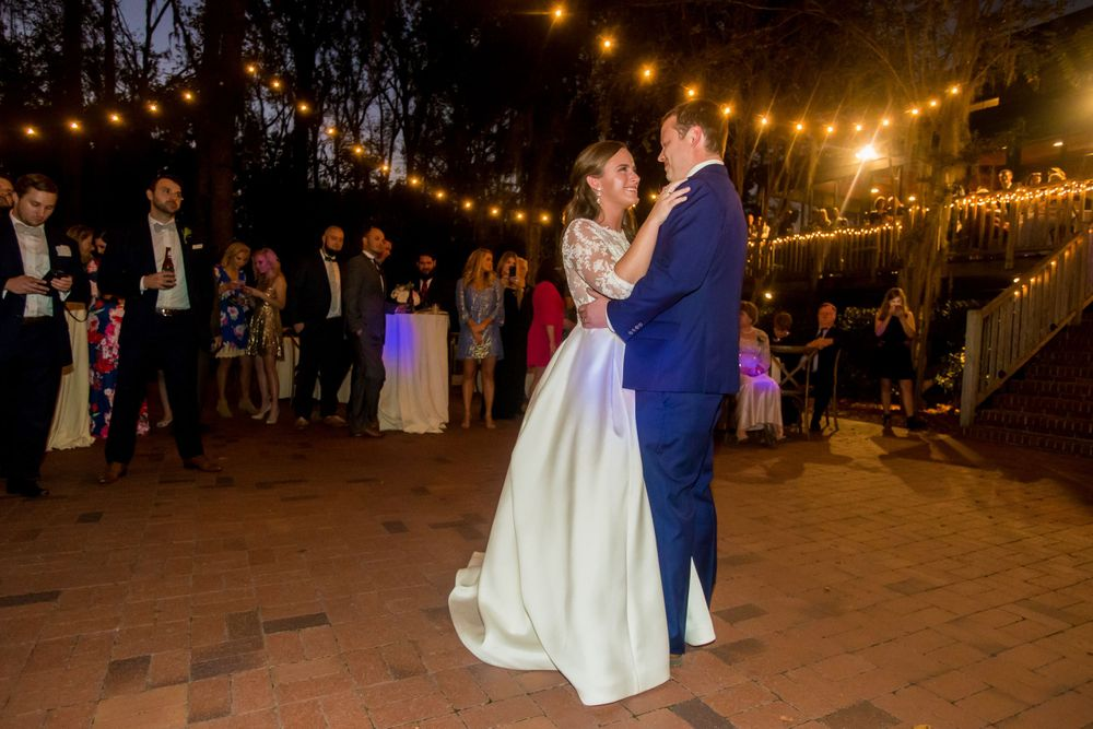 Bride Ashley and groom Paul have their first dance at their wedding reception at Millstone at Adams Pond in Columbia, SC