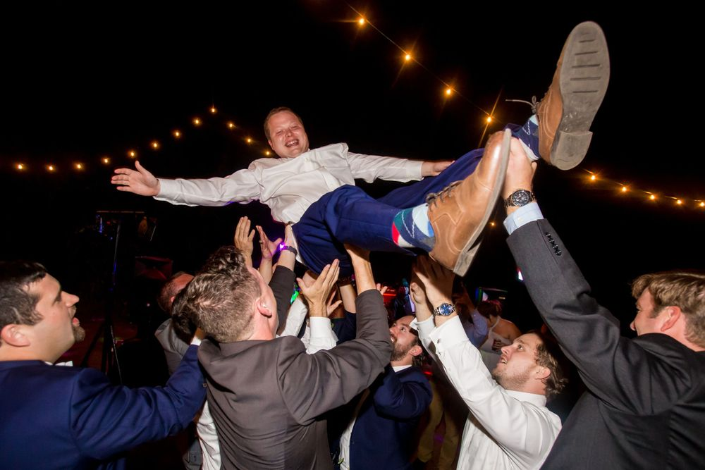 Paul is lifted up by his groomsmen during his wedding reception at the Millstone at Adams Pond in Columbia, SC
