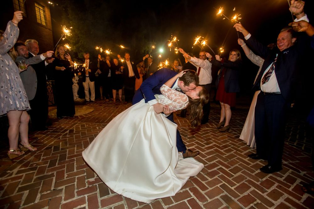 Bride Ashely and groom Paul kiss during their sparkler reception exit at Millstone at Adams Pond in Columbia, SC