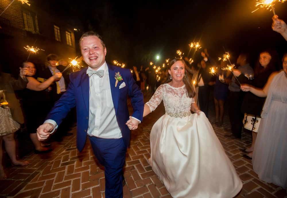 Bride Ashley and groom Paul make their sparkler reception exit from Millstone at Adams Pond in Columbia, SC