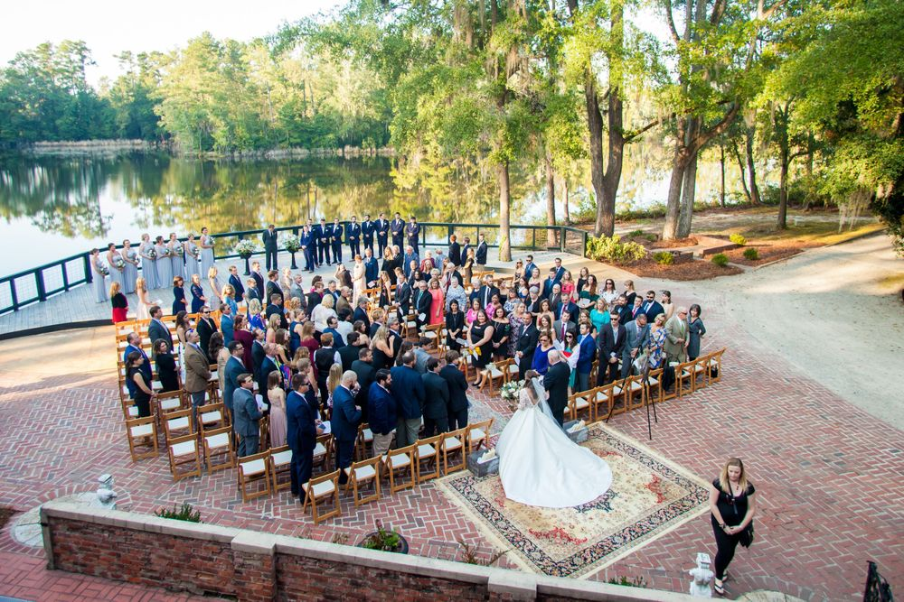 Bride Ashley and groom Paul exchange vows during their wedding ceremony at Millstone at Adams Pond in Columbia, SC