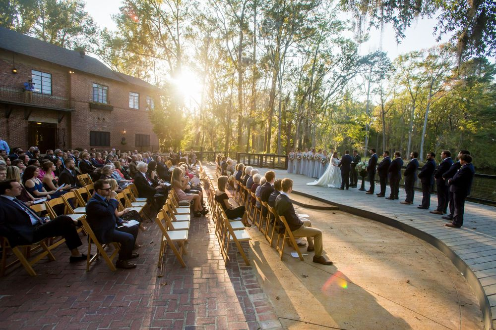 Bride Ashley and groom Paul exchange vows wedding during wedding ceremony at Millstone at Adams Pond in Columbia, SC