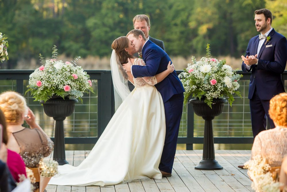 Bride Ashley and groom Paul have their first kiss during their wedding wedding at Millstone at Adams Pond in Columbia SC