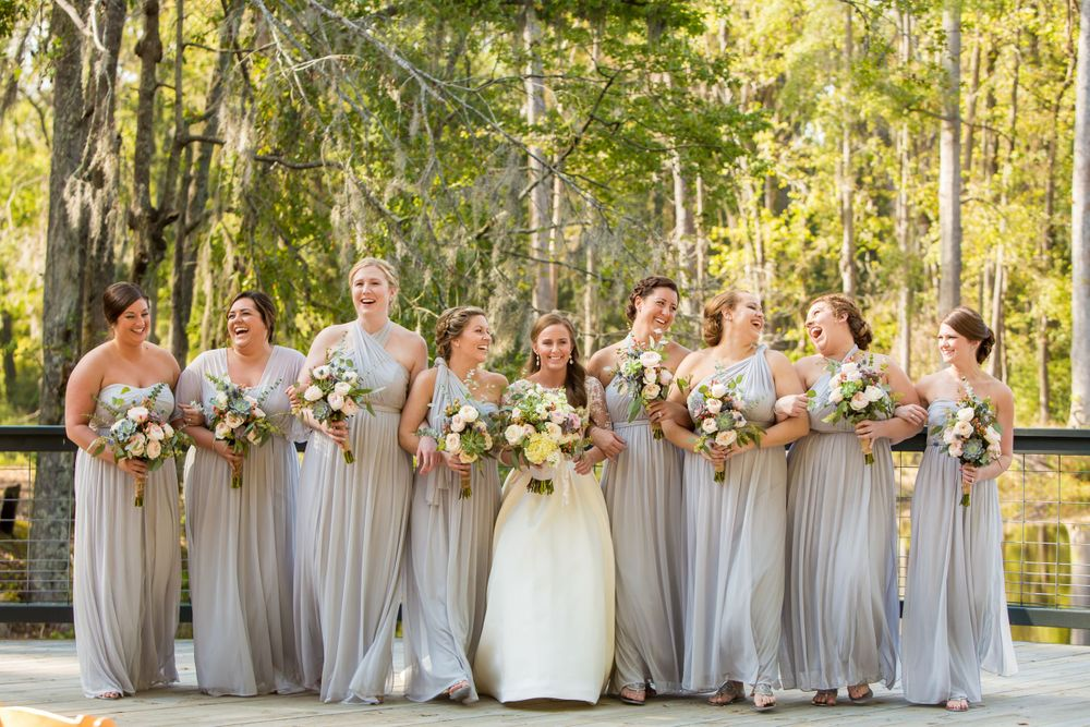 Ashley and her bridesmaids pose before her wedding wedding ceremony at Millstone at Adams Pond in Columbia, SC