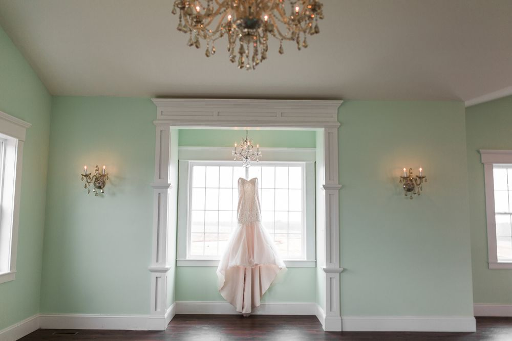 Knob Hill Barn 1892 in Knob Noster, MO.  Wedding Dress hanging in the ball room of the bridal building.