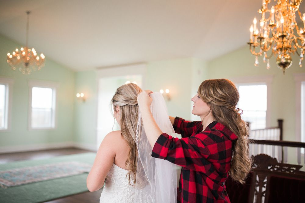 Bride getting here veil in at Knob Hill Barn 1892 in Knob Noster, MO.