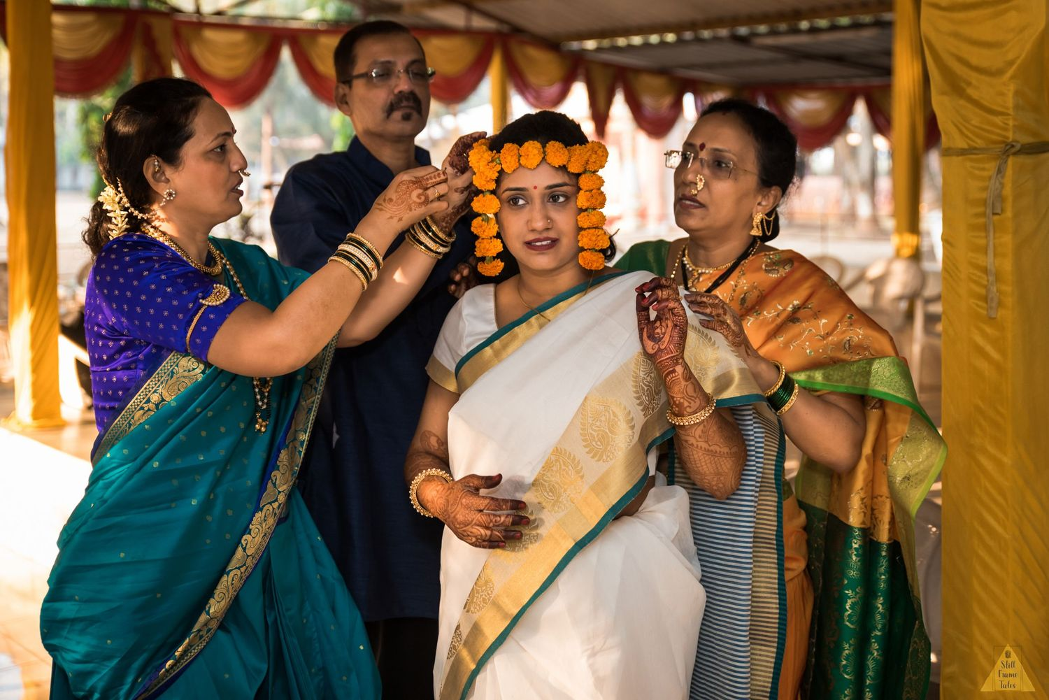 Relatives helping bride with her preparation for a wedding day  puja