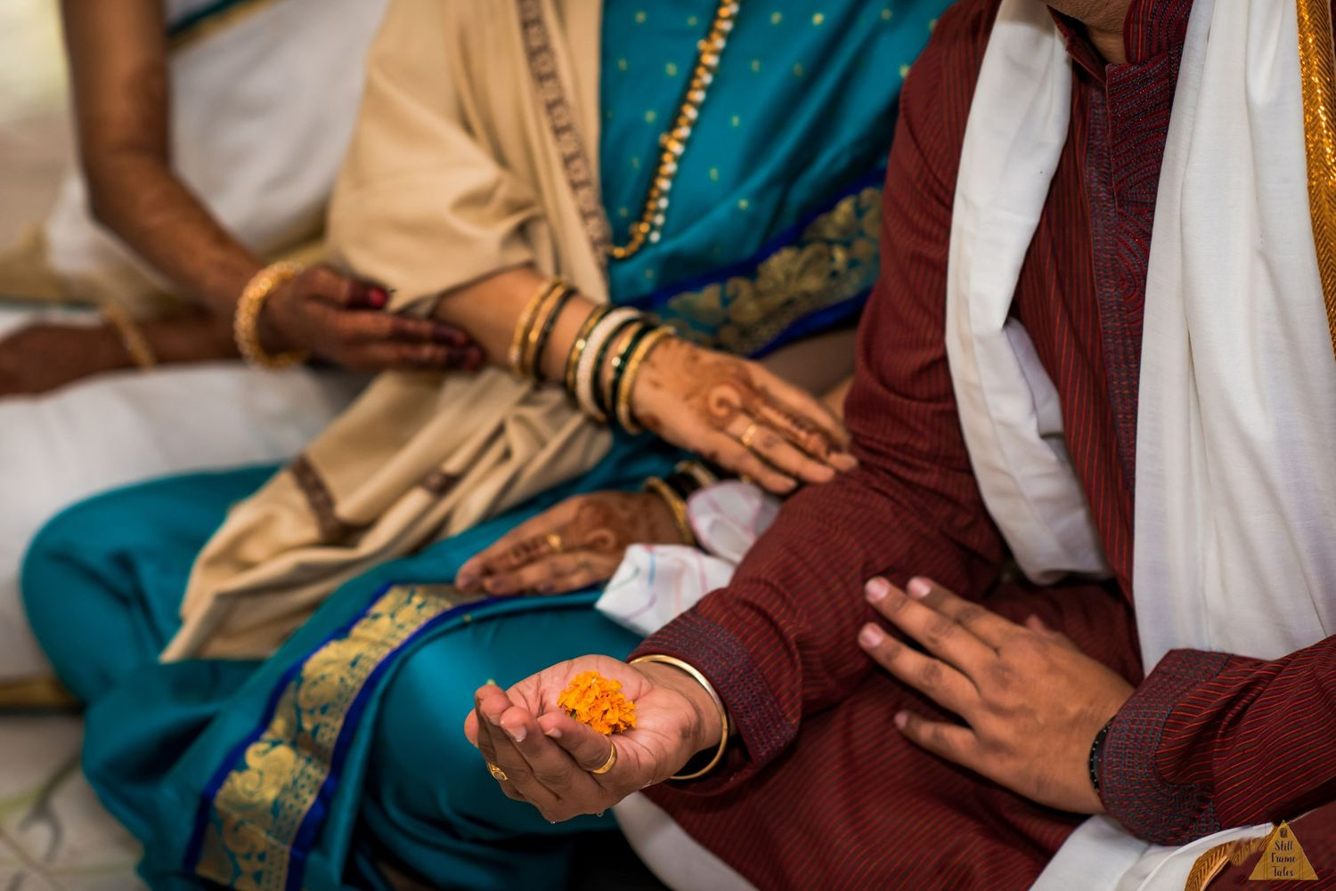 Couple holding and supporting each others hand while doing puja