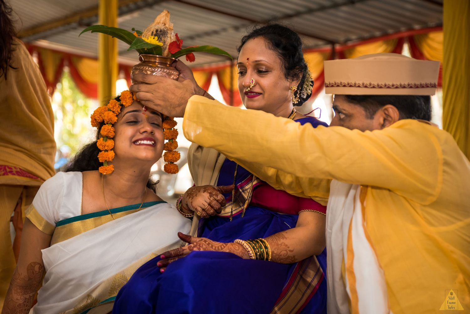 Bride and her parents performing wedding day ritual at a fun weeding ceremony