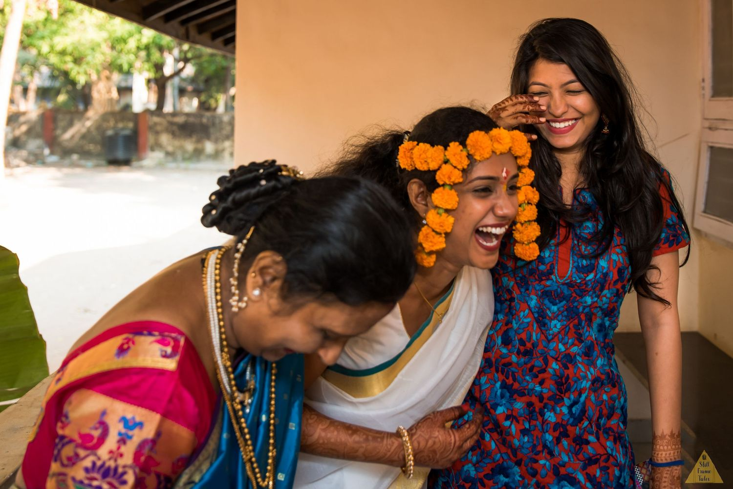 Bride and her friends laughing out loud at a destination wedding