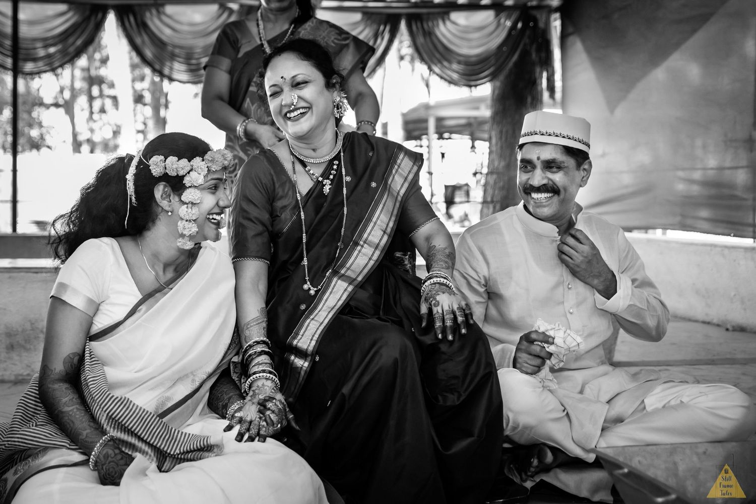 Bride & her parents enjoying and having laugh at a wedding day ritual