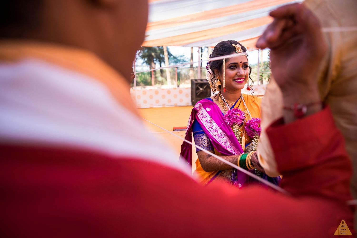 Bride enjoying a wedding ritual with parents