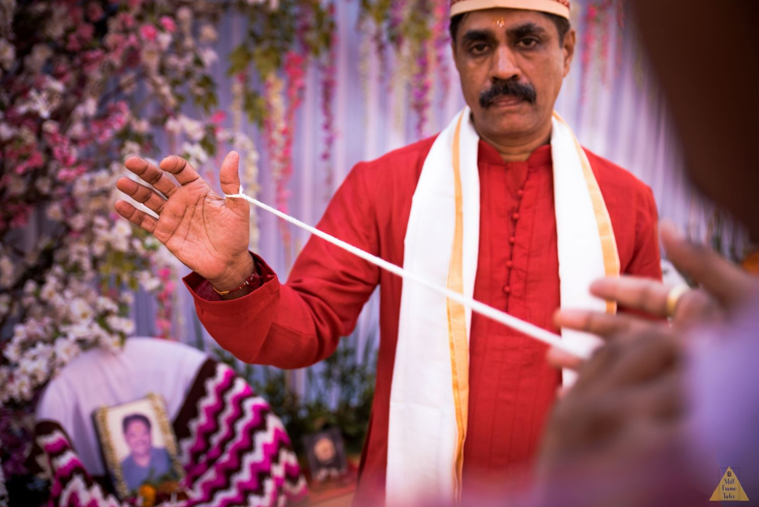 Bride's father performing wedding ritual as per priest guidelines at a destination Marathi wedding