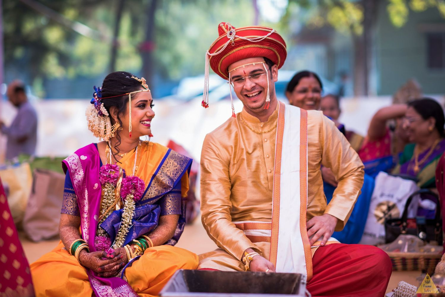 Bride and groom sharing a candid moment during wedding day rituals