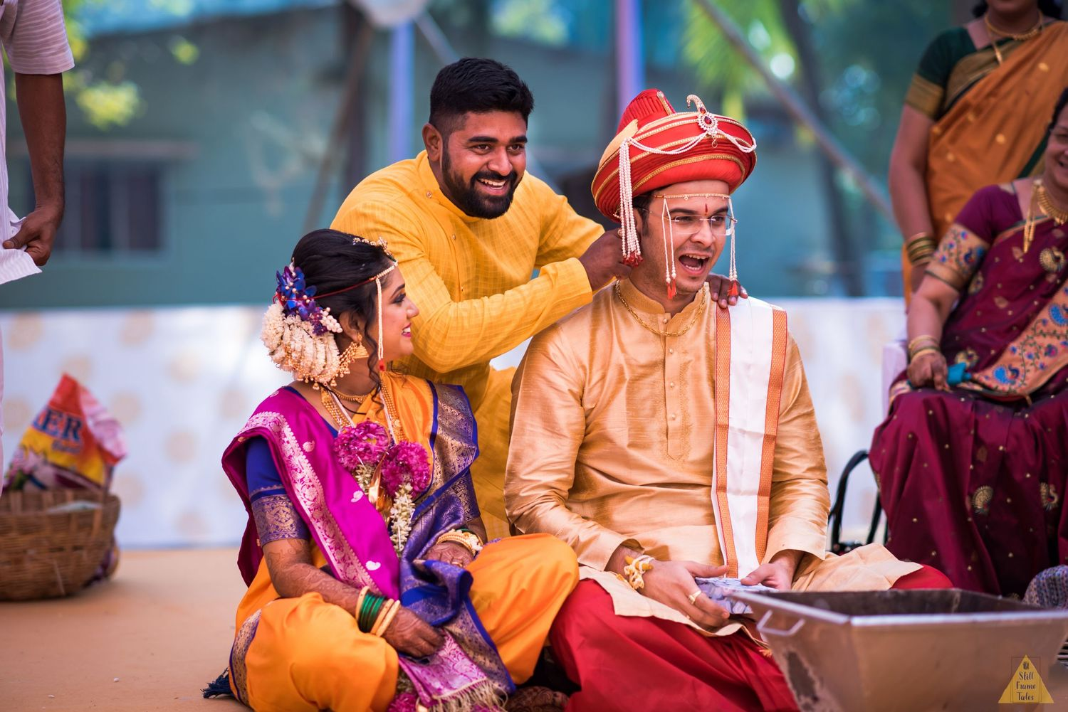 Bride's brother performing a fun wedding ritual on groom at a destination wedding