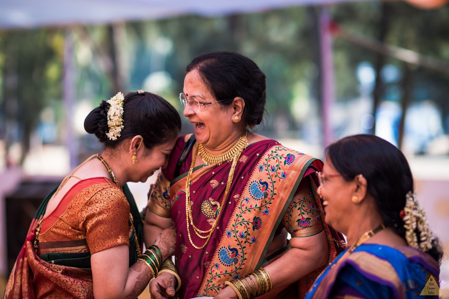 Groom's mother and relatives enjoying and laughing in a candid moment