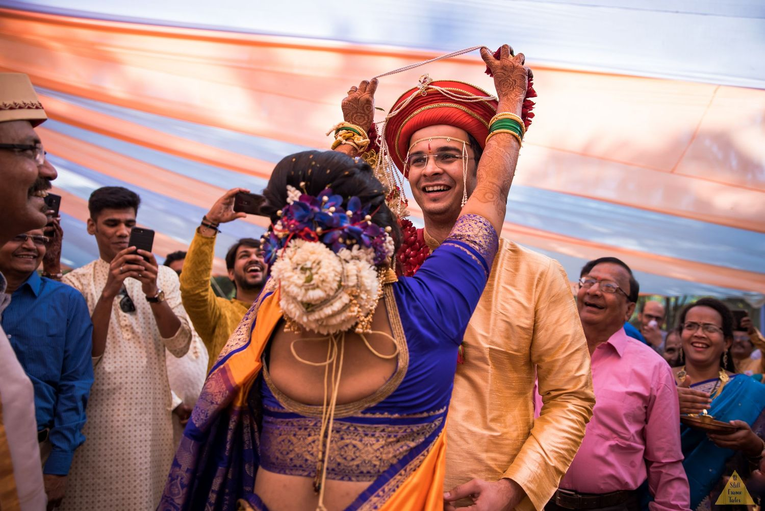 Groom making funny face while exchanging varmala at a destination wedding