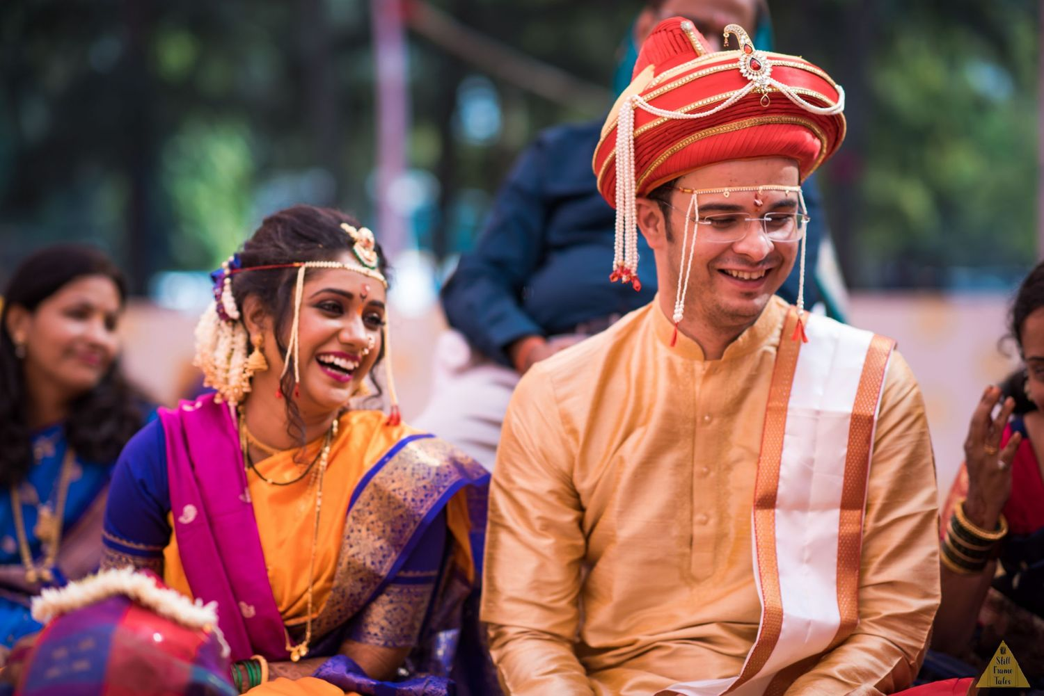 Couple sharing some candid moments at a wedding day puja