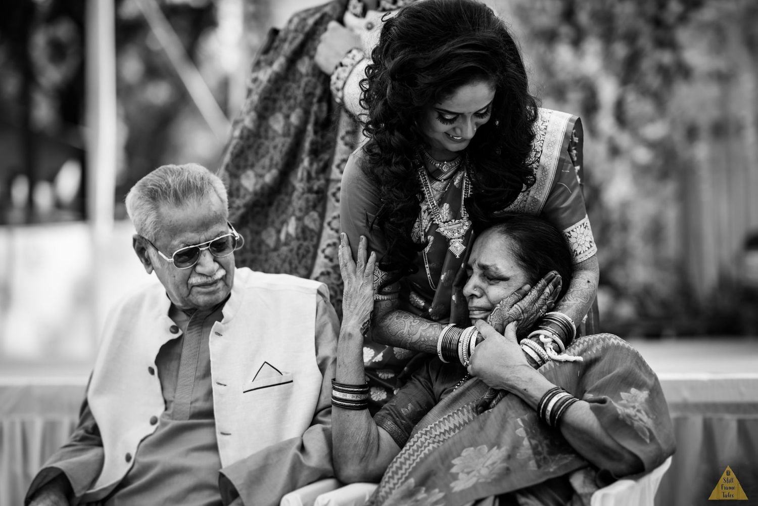 Bride cuddling her grand parents while bidding goodbye to them at a destination wedding