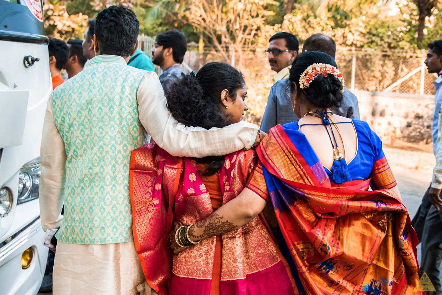 Bride tugging with her parents at her viddai ceremony at a destination wedding