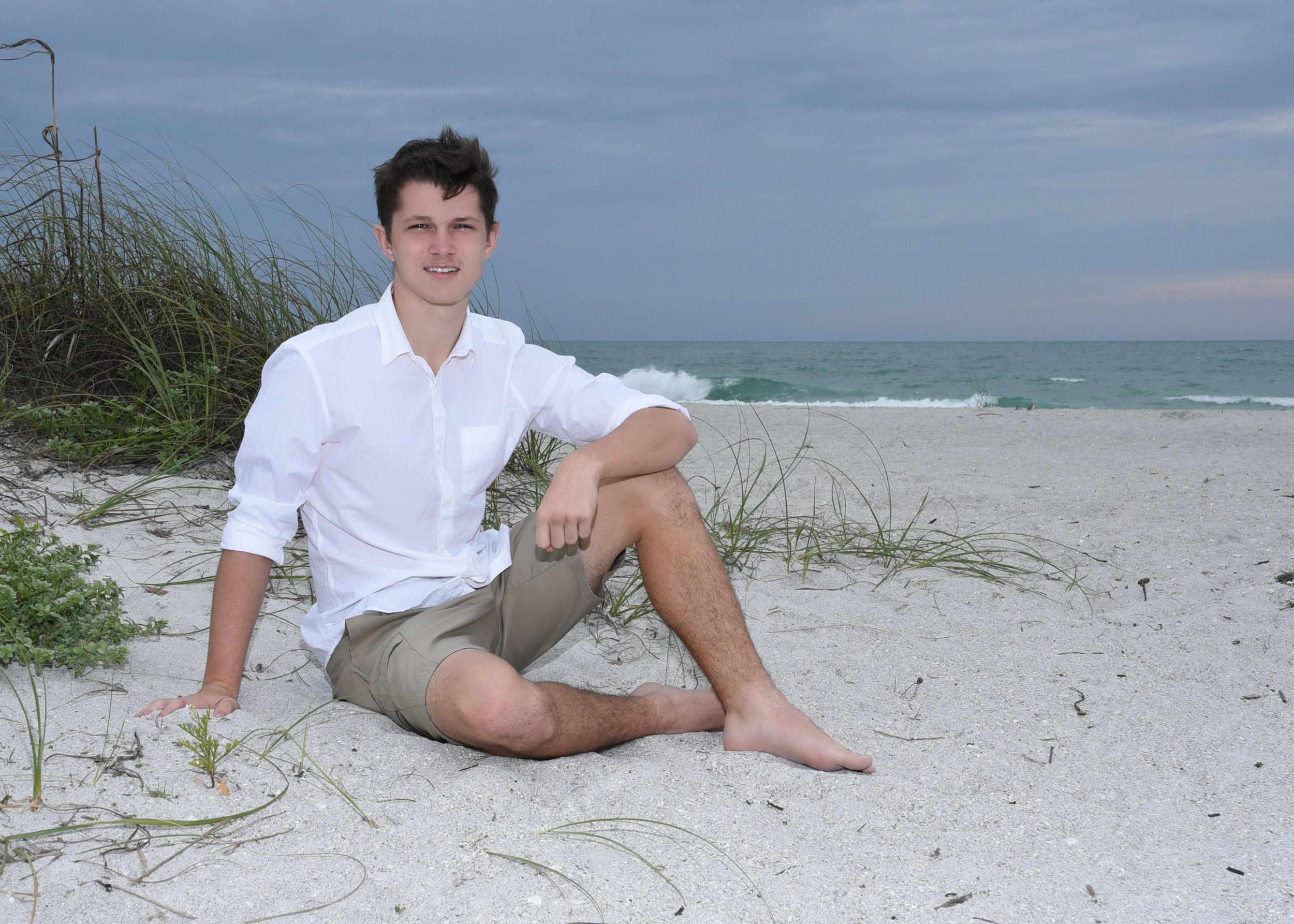 Male high school senior Tarpon Springs beach Florida by Kathleen Hall Photography