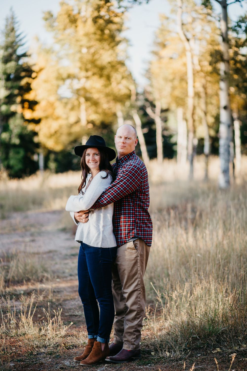 Cute couple pose Colorado Fall Engagement Session