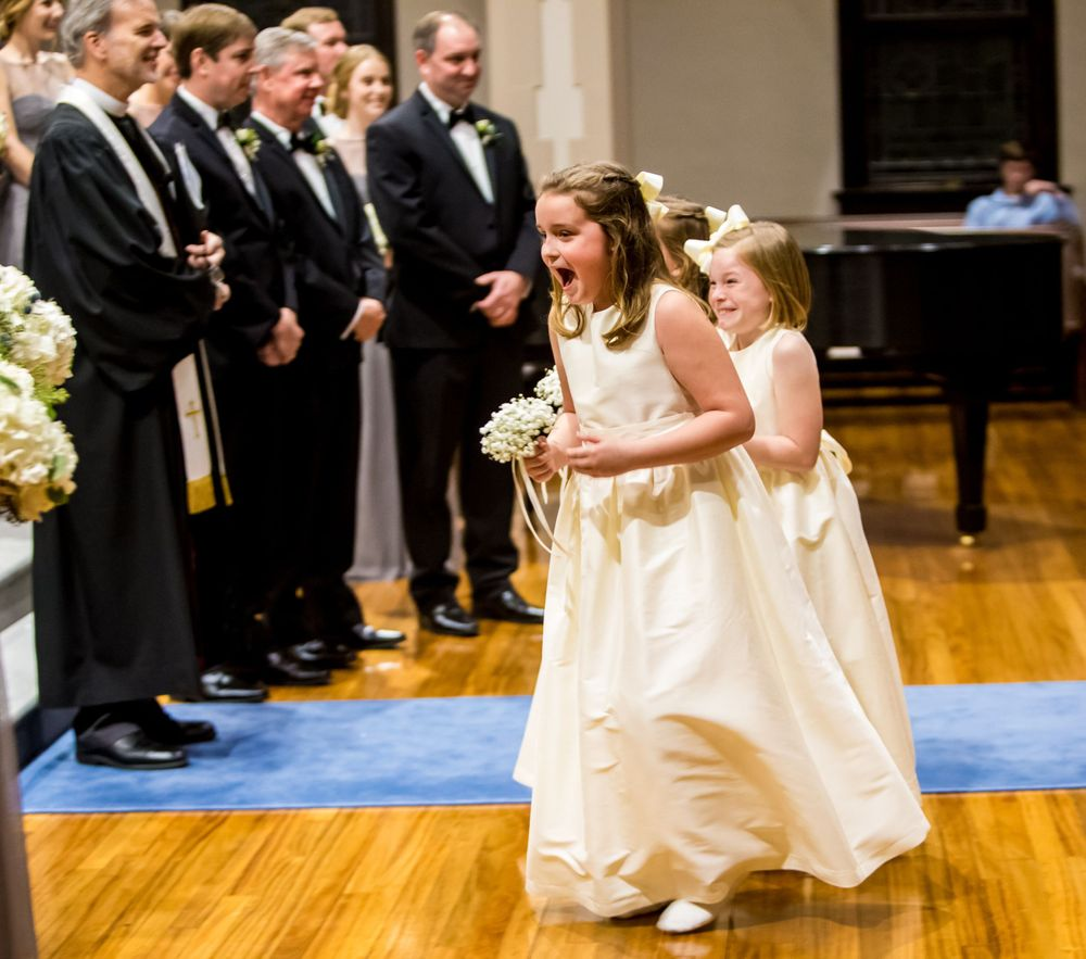 Flower girls react during a wedding ceremony at Shandon Presbyterian in Columbia, SC