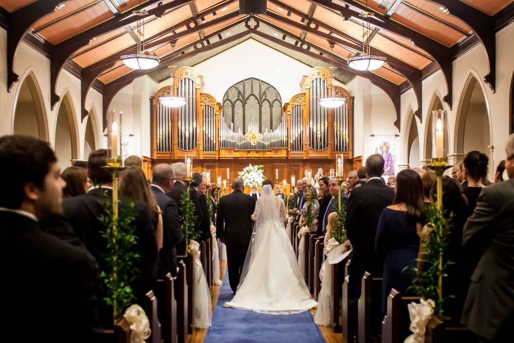 Bride Ferris is walked down the aisle by her father during her wedding ceremony at Shandon Presbyterian in Columbia, SC