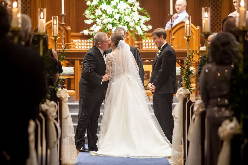 Bride Ferris is kissed by her father during her wedding ceremony at Shandon Presbyterian in Columbia, SC