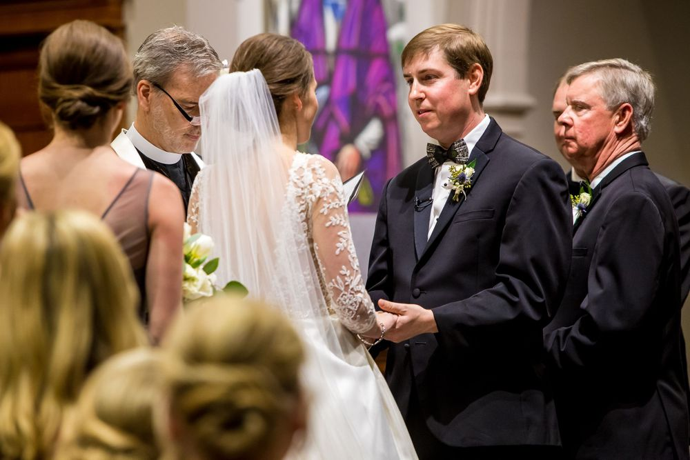 Bride Ferris and groom Chris exchange vows during their wedding ceremony at Shandon Presbyterian in Columbia, SC
