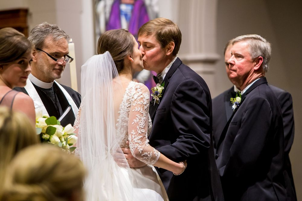 Bride Ferris and groom Chris have their first kiss during their wedding ceremony at Shandon Presbyterian in Columbia, SC