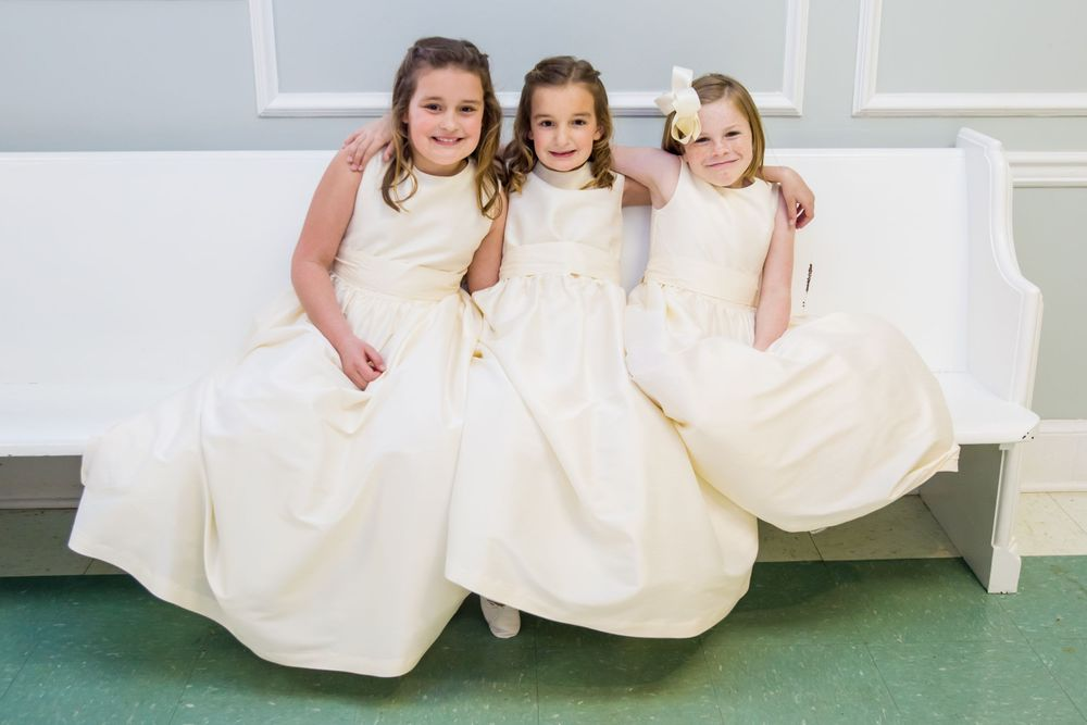 Flower girls pose on a bench before a wedding ceremony at Shandon Presbyterian Church in Columbia, SC