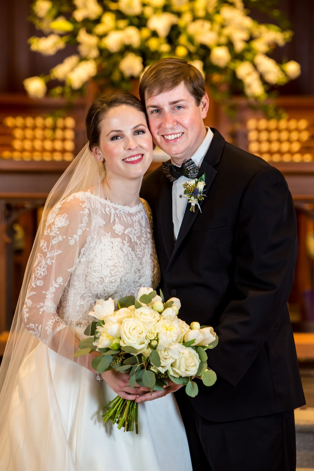 Bride Ferris and groom Chris pose after their a wedding ceremony at Shandon Presbyterian Church in Columbia, SC
