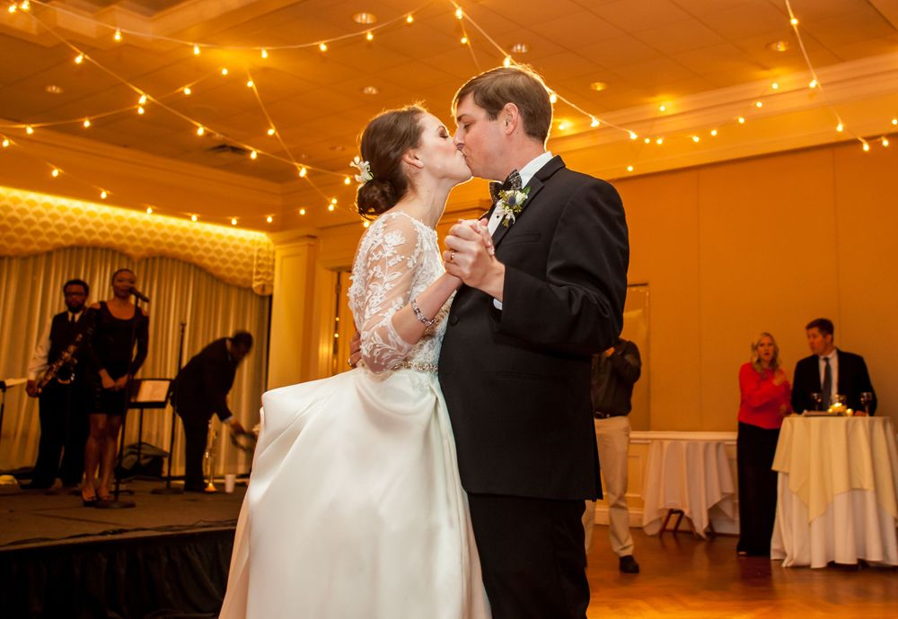 Ferris and Chris kiss during their First Dance at their wedding reception at Forest Lake Country Club in Columbia, SC