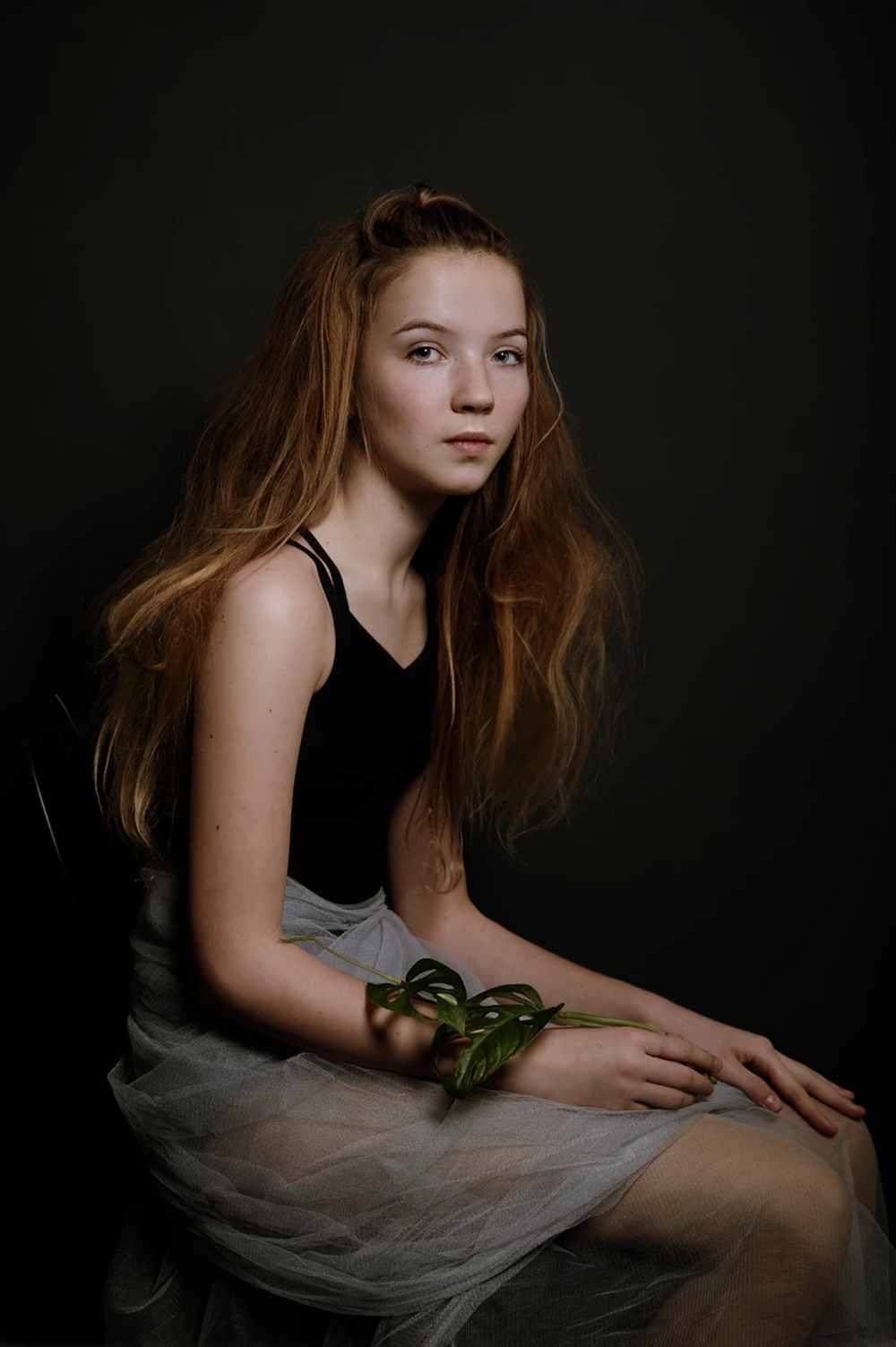 Fine Art Portrait of young girl seated