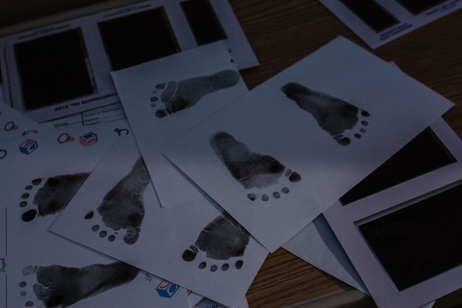Stack of keepsake footprint cards made by the nurse for the family just after baby boy was born in Sioux City, IA.