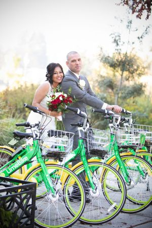 Newly married couple on lime bikes.